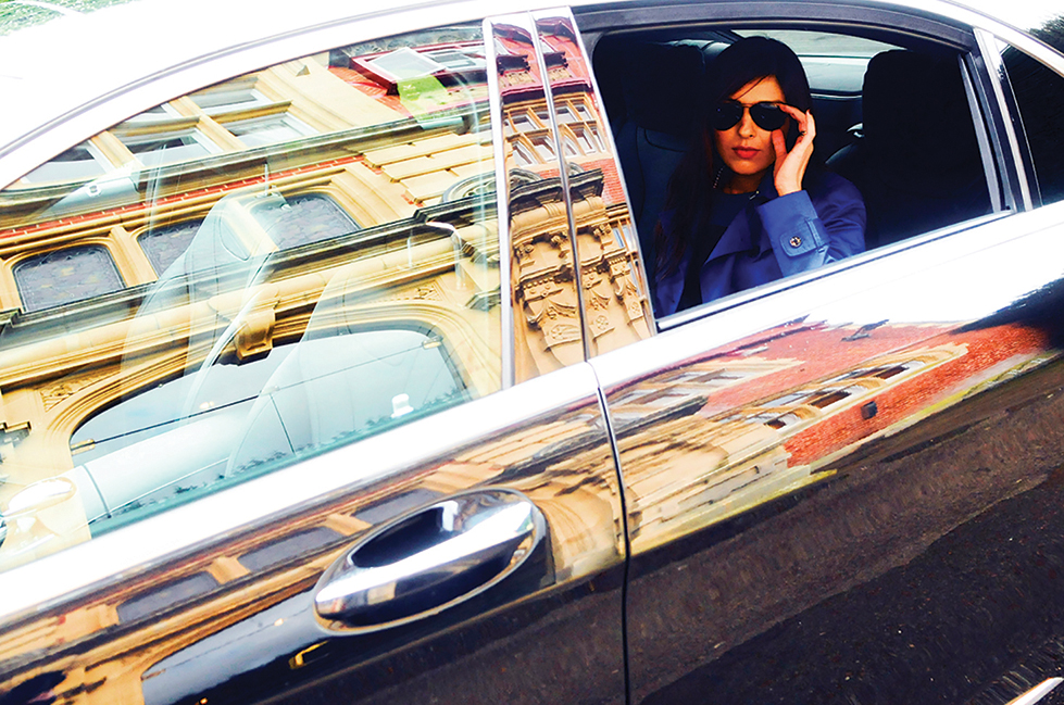 Lady being collected by First class cars chauffeur services